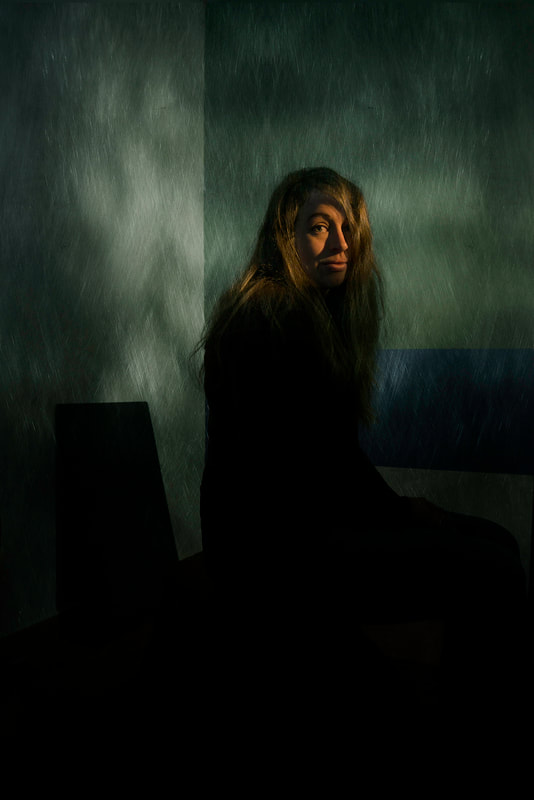 sombre and low key portrait of a woman in subdued light