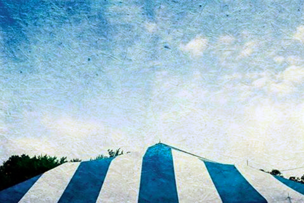 striped tent roof under a blue sky